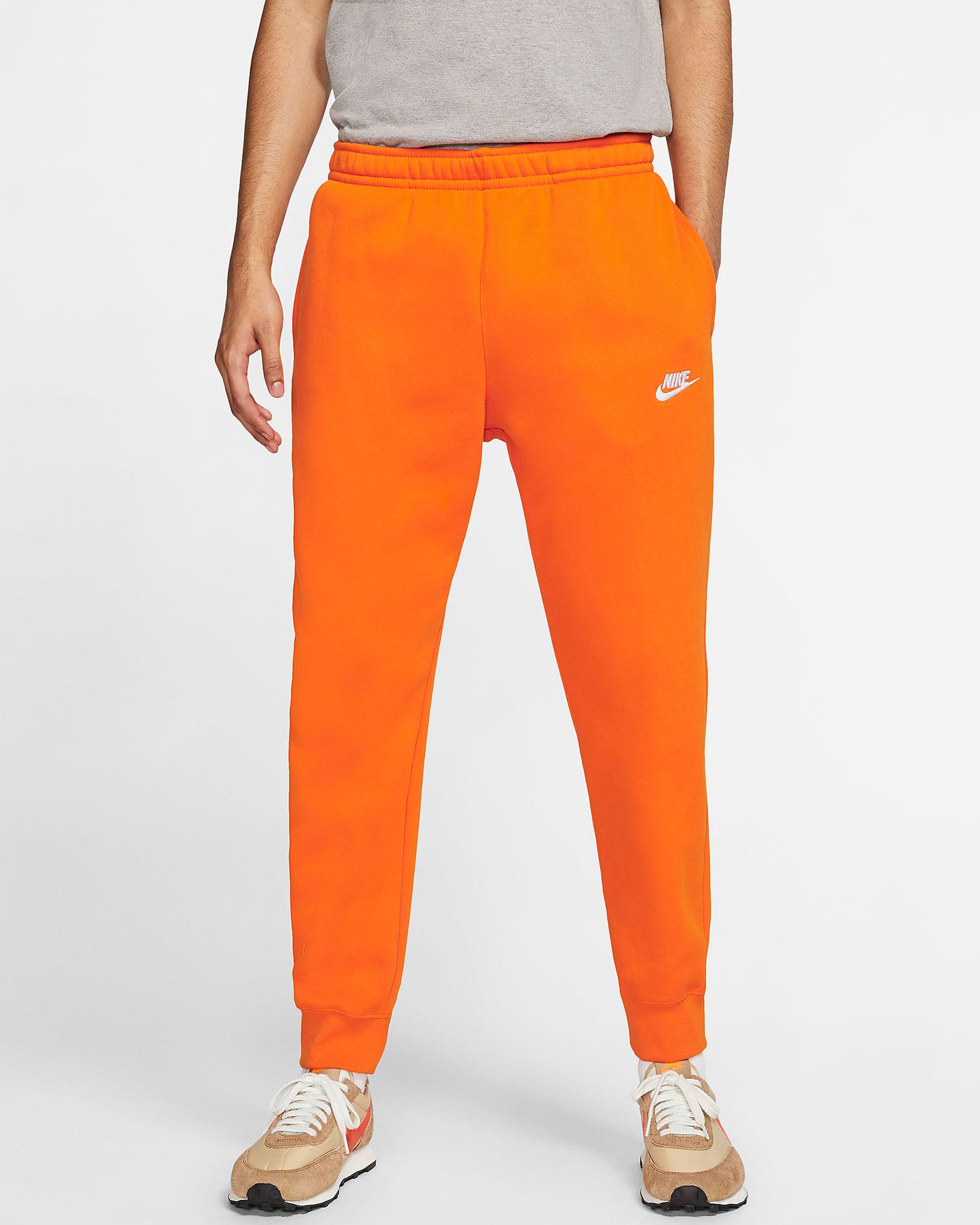 nike-sportswear-orange-jogger-pants