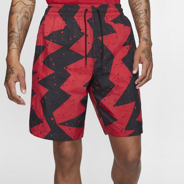black-cement-jordan-11-low-shorts-match-red-1