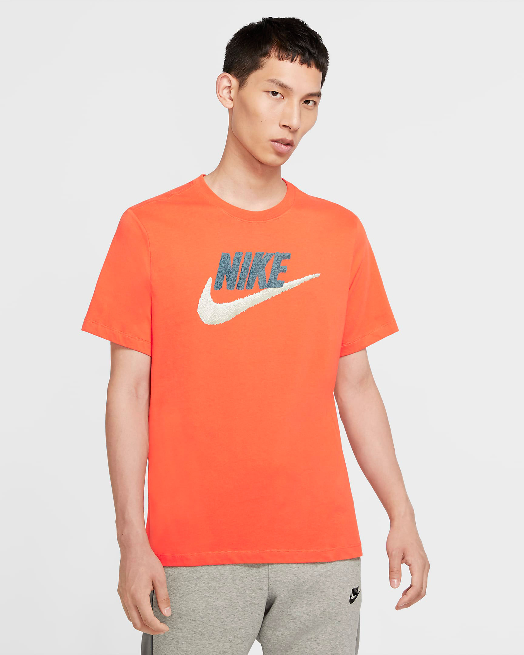 nike-logo-orange-shirt