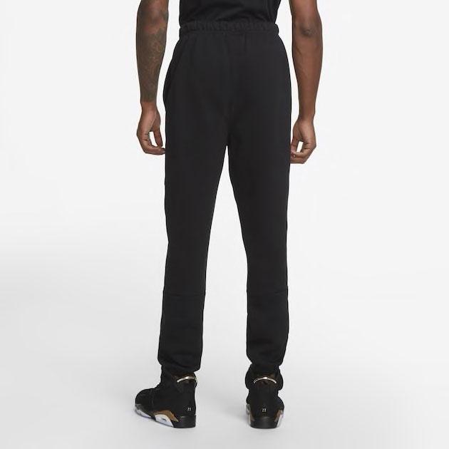 air-jordan-6-dmp-black-gold-pants-2