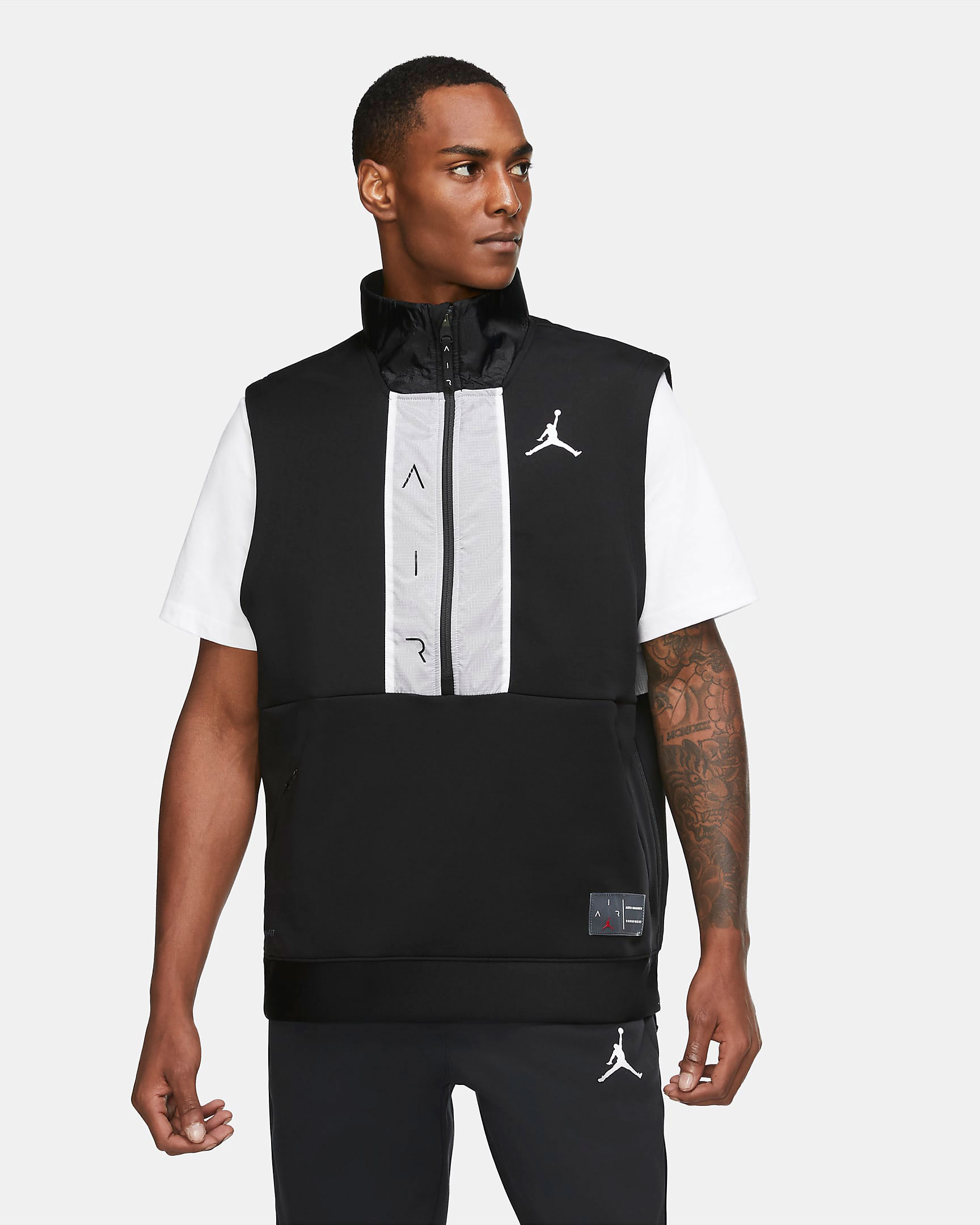 air-jordan-11-jubilee-black-white-jordan-vest-1