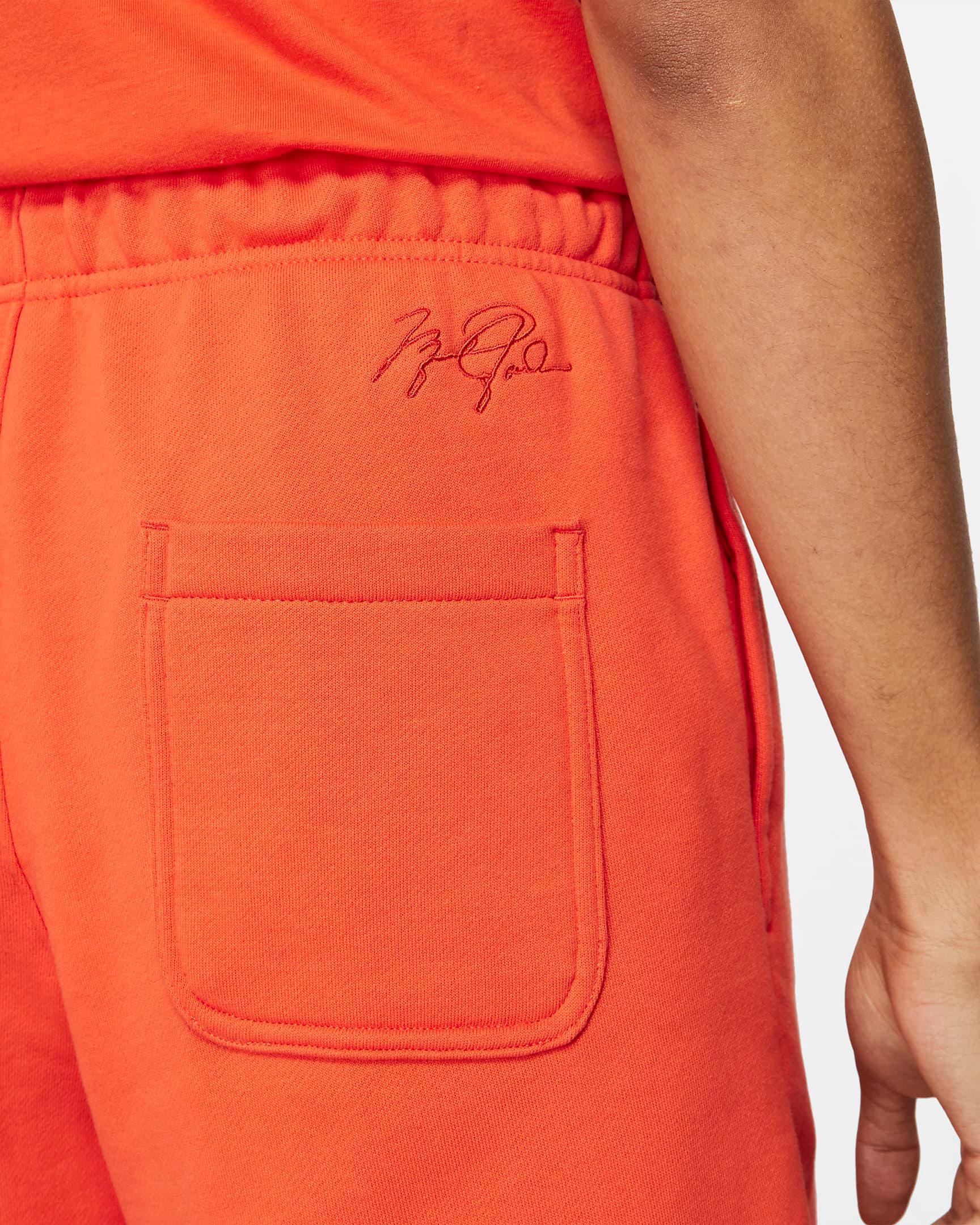 jordan-orange-essential-fleece-shorts-4