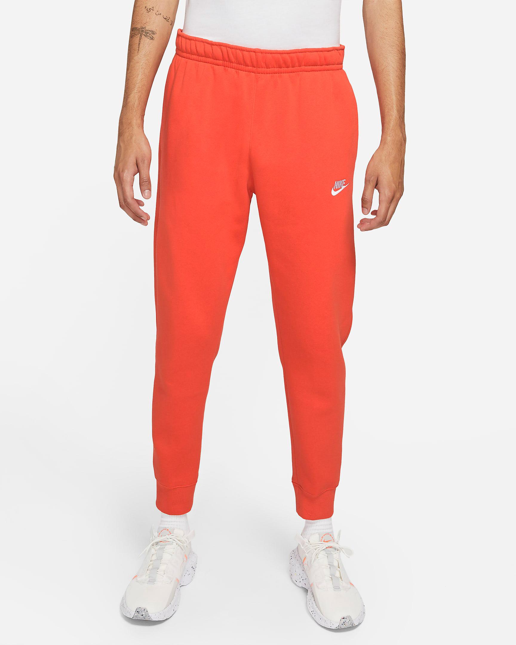 nike-club-fleece-orange-jogger-pants-1